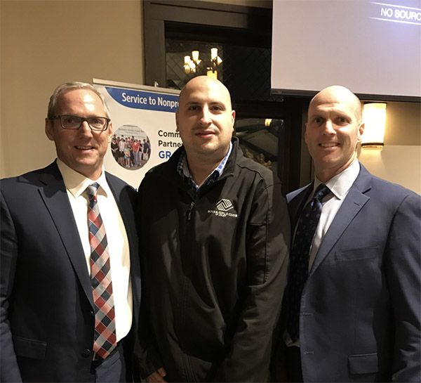 Spesia & Taylor Partners Christian Spesia (left) and John Spesia (right) pose with the Boys and Girls Club of Joliet's President, Khalil Diab (center), at the Community Foundation of Will County's 2018 Grants Award Reception.