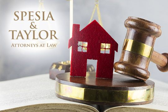 Photo of home with justice gavel, Spesia & Taylor Will & trust attorneys